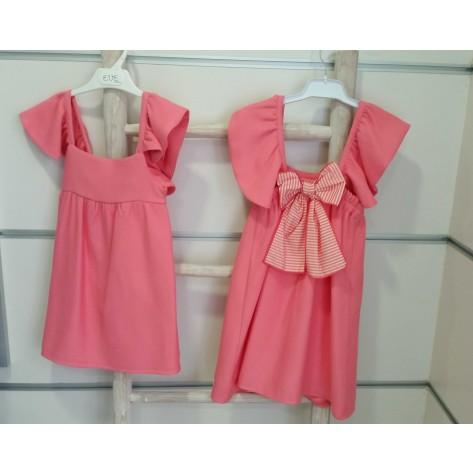 Vestido rosa chicle volante hombros lazo detrás