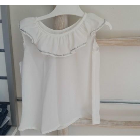 Blusa blanca volante cuello plata