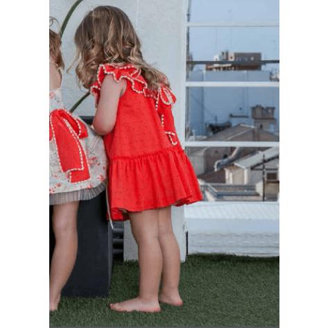 Vestido acuarela plumeti coral lazo espalda